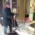 """ll tunisino Salem """"Gaetano"""" Hamdi mentre """"lavora"""" all'ingresso del supermercato Coop in corso Amendola ad Ancona"""